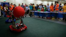 Robot at Maker Faire with enthusiastic fans